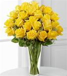 24 Yellow Roses Arranged in A Clear Glass Vase with Greens