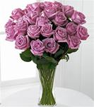 24 Lavender Roses Arranged in A Clear Glass Vase with Greens