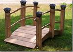 High Arch Red Oak Garden Bridge with solar lights
