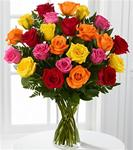 24 Mixed Colored Roses Arranged in A Clear Glass Vase