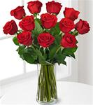 12 Red Roses Arranged in a Clear Glass Vase with Greens