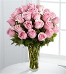 24 Pink Roses Arranged in A Clear Glass Vase with Greens