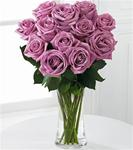12 Lavender Roses Arranged in Clear Glass Vase with Greens