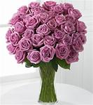 36 Lavender Roses Arranged in A Clear Glass Vase with Greens