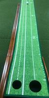 A Perfect Putting mat with 2 cup sizes and ball return