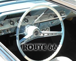 1961 Chevy Impala vintage car's baby blue and white interior with steering wheel and dashboard that says 'Route 66' in clear letters