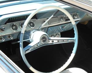 1961 Impala vintage car's baby blue and white interior with steering wheel and dashboard