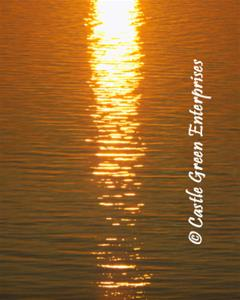 Orange ripples in orange and golden water during sunset