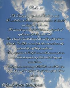 Psalm 23, the Lord's Prayer, is written in silver script over a background of blue sky and white clouds