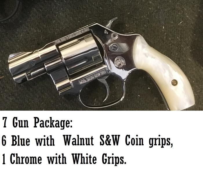 7 gun package; 6 blue with walnut, 1 chrome white grips