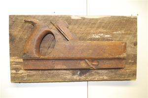 Vintage wood plane on barn board