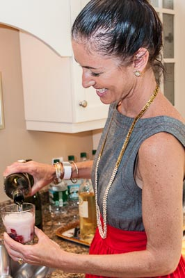 Debi Lilly pouring a muddled drinkl