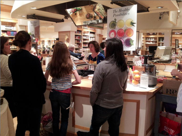 Picture of Faye giving a cooking class in March 2014