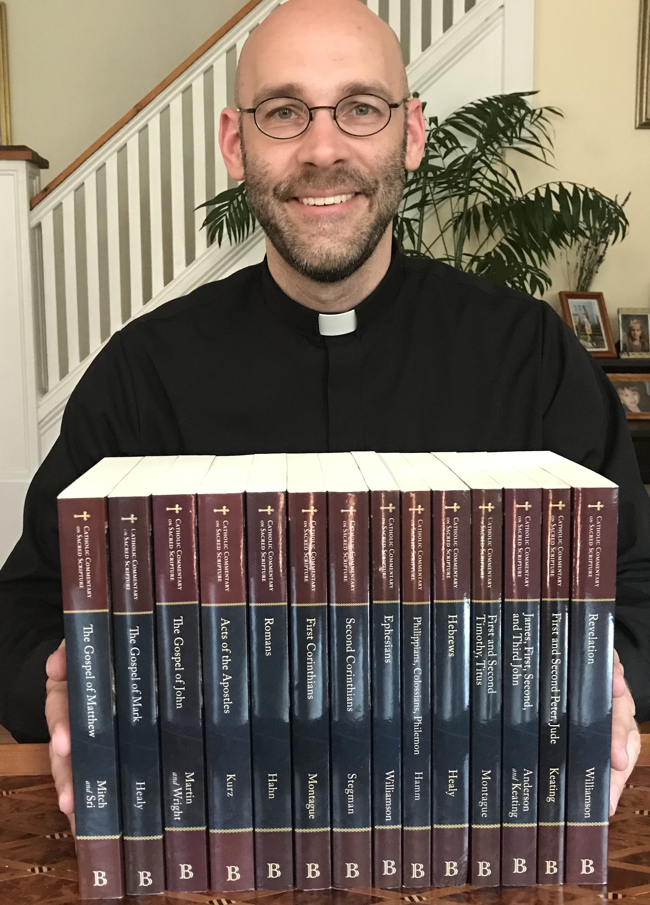 Fr. Jim Smith with his gift set of commentaries