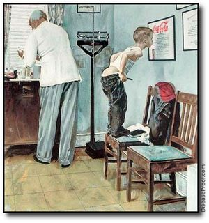 In doctors office. Kid is standing on chair looking at doctors certificate