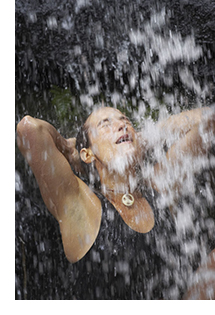 Woman being drenched with water